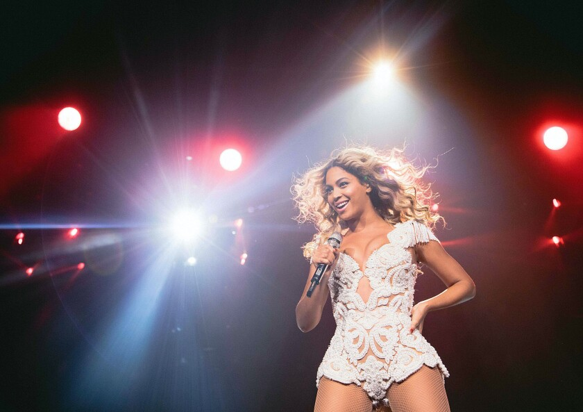 Beyonce performs onstage as part of her Mrs. Carter World Tour last week in Phoenix.