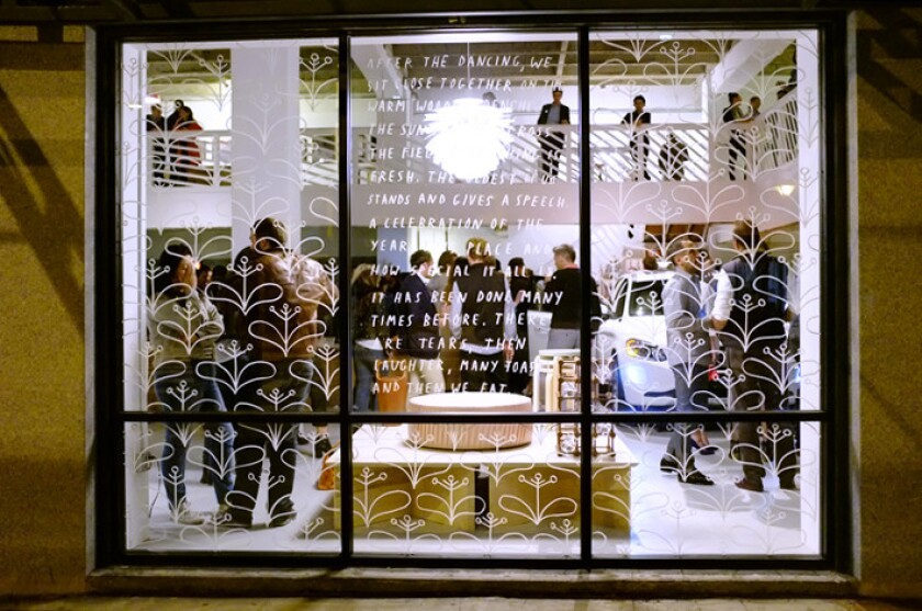 Austere's 5,000-square-foot showroom, viewed through artist Brian Rea's window display, is at 9th and Hill streets in downtown Los Angeles.