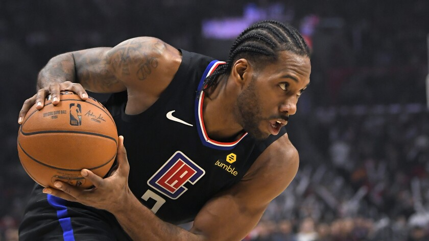 Clippers forward Kawhi Leonard moves toward the basket during an NBA game against the Denver Nuggets at Staples Center.