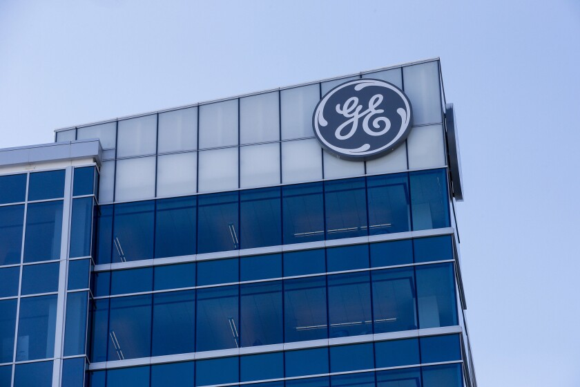 In this Tuesday, Jan. 16, 2018, photo, the General Electric logo is displayed at the top of their Global Operations Center in the Banks development of downtown Cincinnati.