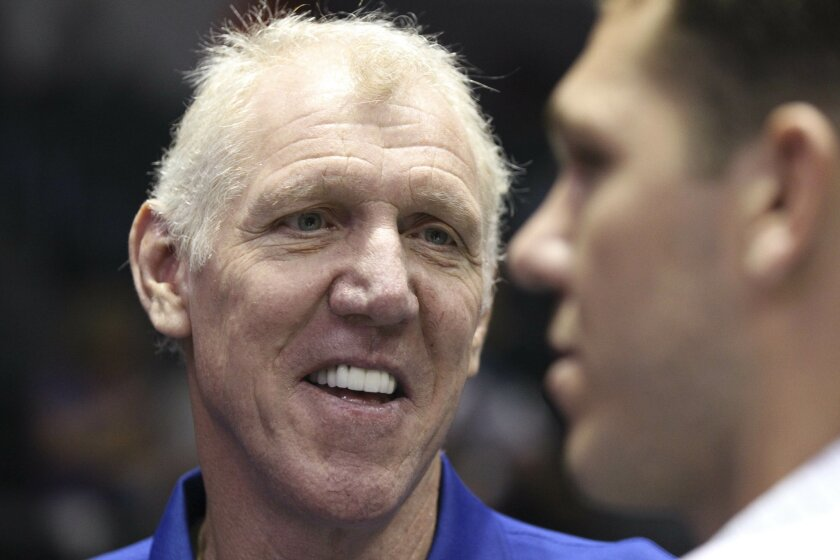 Retired NBA star Bill Walton, left, talks to his son and interim coach of the Golden State Warriors before the start of the NBA preseason game between the Lakers and the Golden State Warriors.