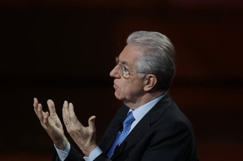 """Italian Premier Mario Monti gestures as he speaks during the Italian State RAI TV program """"Che Tempo che Fa"""", in Milan, Italy, Sunday, Jan. 8, 2012. No European nation is strong enough to ride out the continent's debt crisis alone, Italy's new premier insisted Saturday, urging fellow EU members to develop a common growth policy. Monti will meet with German Chancellor Angela Merkel in Berlin on Wednesday and at a major European summit in Brussels at the end of the month. (AP Photo/Luca Bruno)"""
