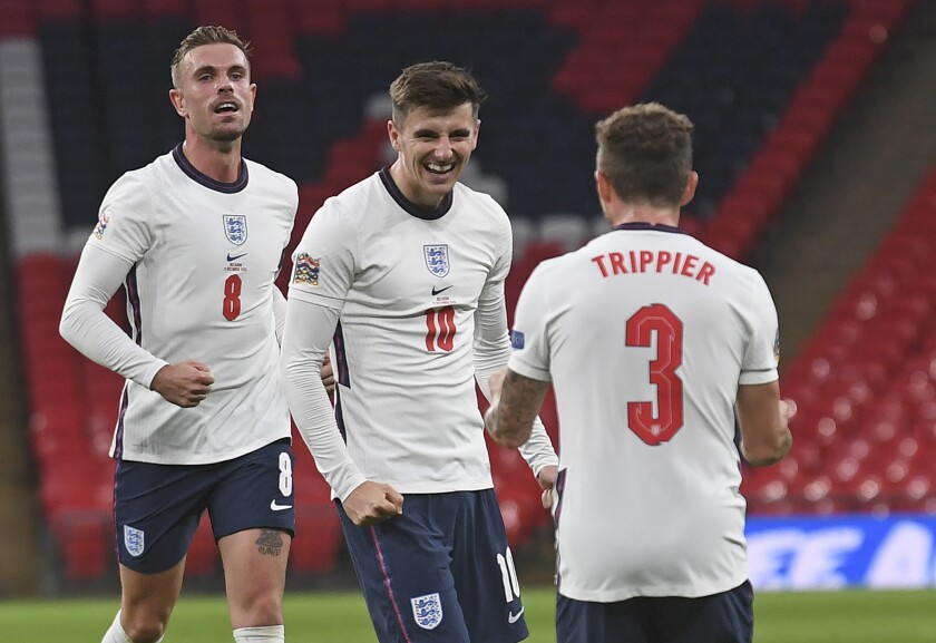 England's Mason Mount, center, celebrates after scoring his side's second goal during the UEFA Nations League soccer match between England and Belgium at Wembley stadium in London, Sunday, Oct. 11, 2020. (Neil Hall/Pool via AP)