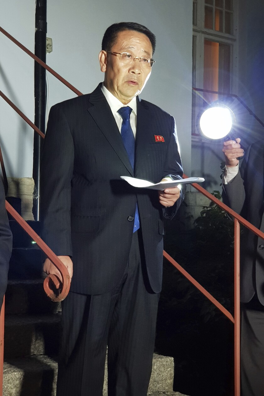 """In this Oct. 5, 2019 FILE photo, North Korean negotiator, Kim Miyong Gil speaks outside the North Korean Embassy in Stockholm, Sweden, Saturday, Oct. 5, 2019. North Korea is calling an outside condemnation of its weapons launches a """"grave provocation"""" and threatening to resume nuclear and long-range missile tests. (Yonhap/Pool photo via AP, File)"""