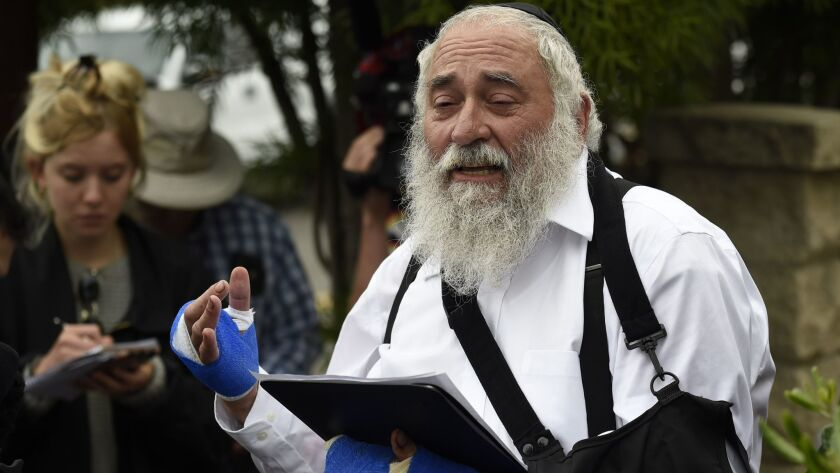 Rabbi Yisroel Goldstein speaks at a news conference at the Chabad of Poway synagogue, Sunday, April