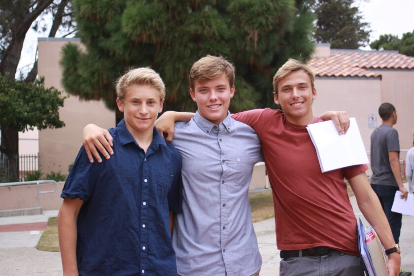 Incoming juniors Cordon Baesel, David Broms and Noah Brown meet up during registration day at La Jolla High School, Sept. 1.