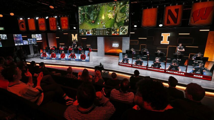 """Fans watch a match between the University of Maryland, left, and the University of Illinois in the Big Ten Network """"League of Legends"""" championship in the Battle Theater at North American League Championship Arena at Riot Games in Los Angeles in 2017."""