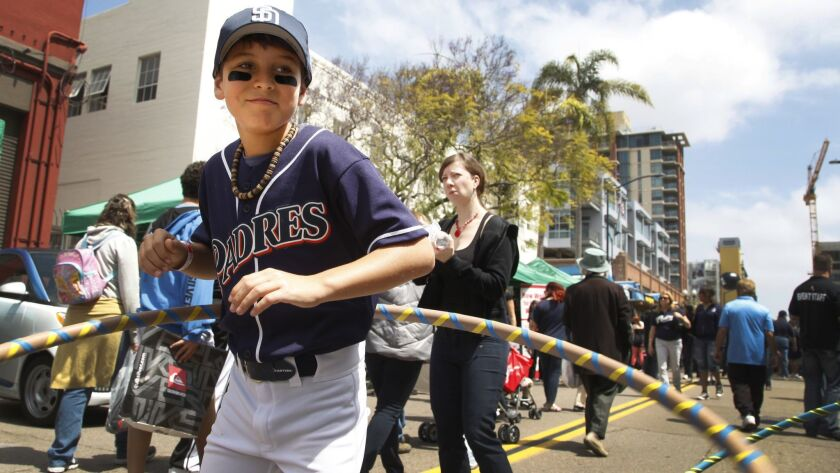 Ethan Kron, 10 of San Diego warmed up with a hula hoop at the East Village Block Party before attending the Padres Home Opener with his father and brother.