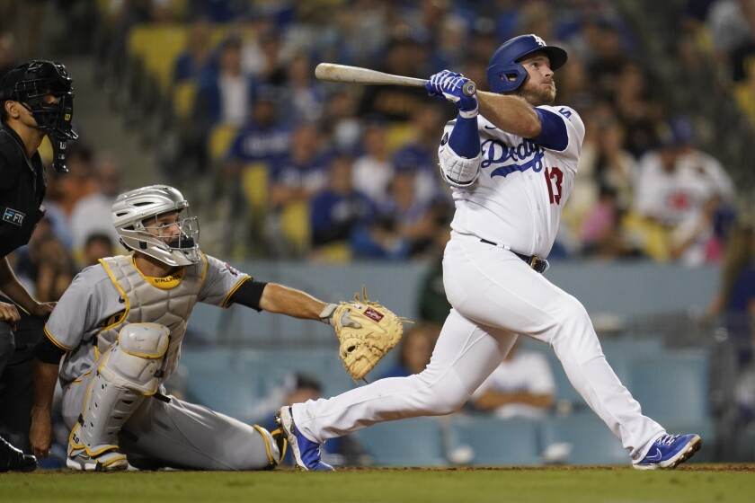 Los Angeles Dodgers' Max Muncy follows through on his solo home run during the eighth inning of a baseball game against the Pittsburgh Pirates Monday, Aug. 16, 2021, in Los Angeles. (AP Photo/Marcio Jose Sanchez)