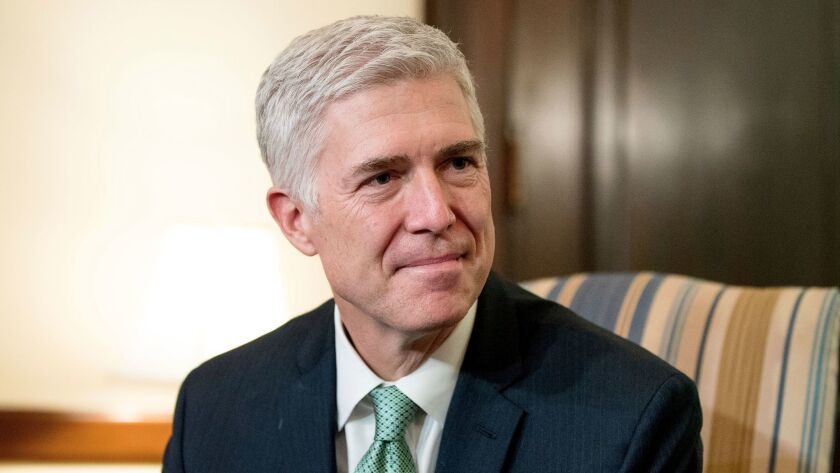 Supreme Court Justice nominee Judge Neil Gorsuch meets with Sen. Chris Coons, D-Del. on Capitol Hill in Washington on Feb. 14.