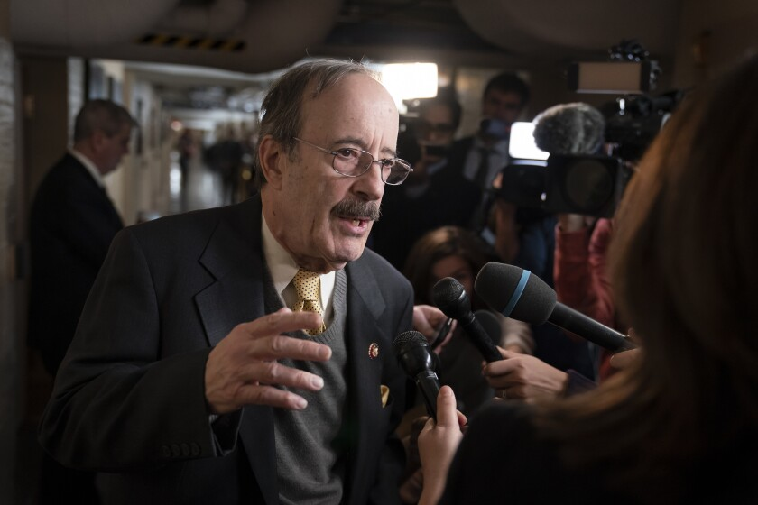 FILE - In this Dec. 17, 2019, file photo House Foreign Affairs Committee Chairman Eliot Engel, D-N.Y., talks to reporters as before he meets with fellow House Democrats at the Capitol in Washington. Amy McGrath and Engel live hundreds of miles apart in states with dramatically different politics. Yet they are both the preferred candidates of the Democratic Party's Washington establishment as voters in Kentucky and New York decide their congressional primary elections on Tuesday. And both may be in trouble.(AP Photo/J. Scott Applewhite, File)