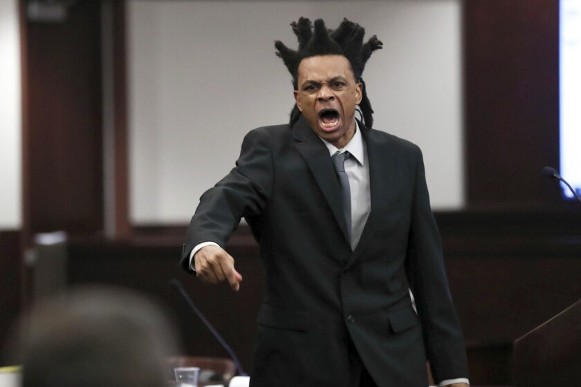 Ronnie Oneal III gives his opening statement during his murder trial at the George Edgecomb Courthouse Monday, June 14, 2021, in Tampa, Fla. Oneal is accused of two counts of first-degree murder in the killings of his girlfriend Kenyatta Barron and their 9-year-old daughter, Ron'Niveya Oneal. He is also accused of attempting to kill his then-8-year-old son. (Arielle Bader/Tampa Bay Times via AP)