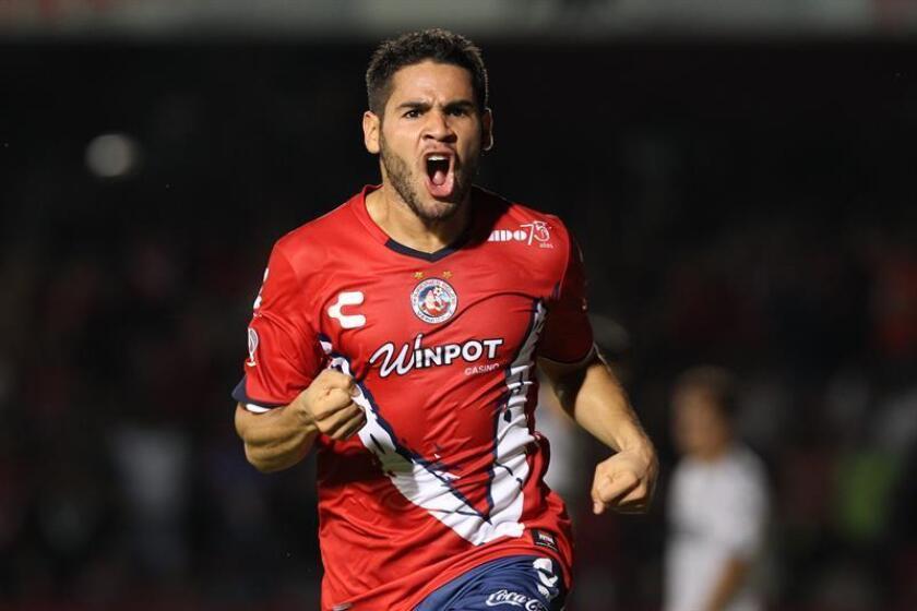 El jugador de Tiburones Daniel Villalva celebra después de anotar un gol en el estadio Luis Pirata Fuente de Veracruz (México). EFE/Archivo
