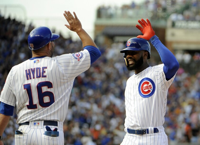 Chicago Cubs' Jason Heyward, right, celebrates with first base coach Brandon Hyde (16) after hitting an RBI-single against the San Francisco Giants during the ninth inning of a baseball game, Sunday, Sept. 4, 2016, in Chicago. (AP Photo/David Banks)