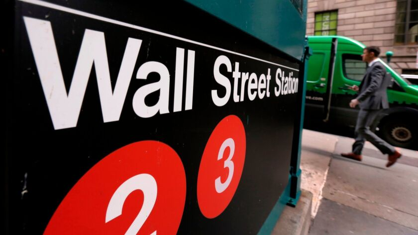 This April 5, 2018, photo shows a sign for a Wall Street subway station in New York. The U.S. stock