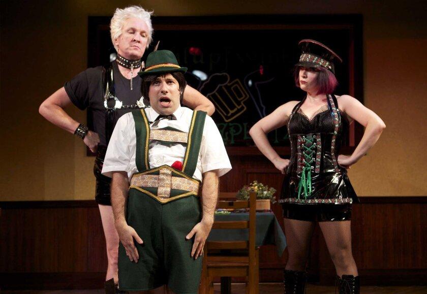 Kevin B. McGlynn, Omri Schein and Kristen Mengelkoch raise the roof with laughs in scene three, set in the Der Schlumpfwinkel Speiseplatz restaurant. Photo Aaron Rumley