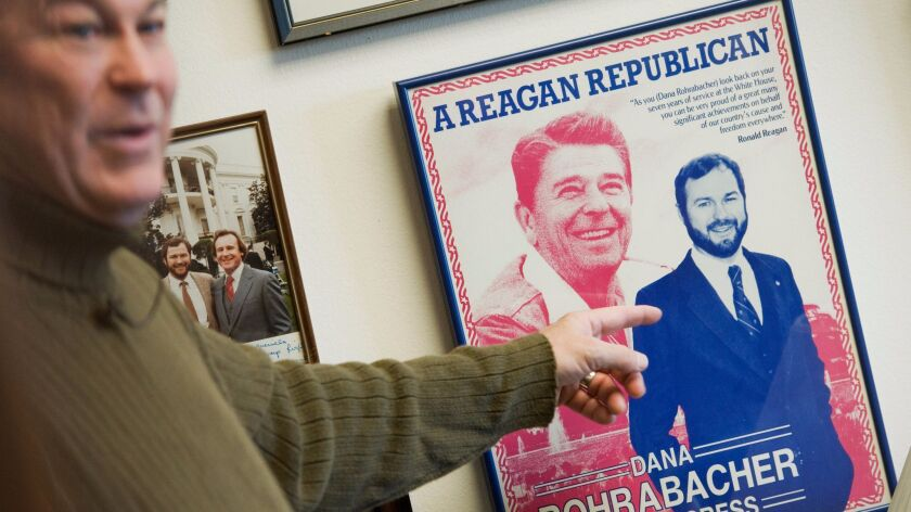 Rep. Dana Rohrabacher (R-Costa Mesa) talks about a campaign poster with his image alongside Ronald Reagan's while giving a tour of his Rayburn Building office in Washington on March 12.