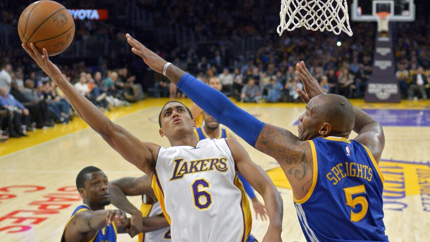 Lakers guard Jordan Clarkson, left, puts up over Golden State Warriors forward Marreese Speights in the Lakers' 136-115 loss at Staples Center on Nov. 16.