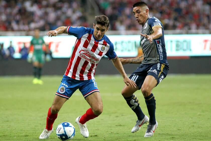 Isaac Brizuela (L) of Guadalajara vies for the ball with Ricardo Centurion of Atletico San Luis during the Mexican Apertura 2019 tournament football match between Guadalajara and Atletico San Luis in Guadalajara, Mexico, on August 10, 2019. (Photo by Ulises Ruiz / AFP)ULISES RUIZ/AFP/Getty Images ** OUTS - ELSENT, FPG, CM - OUTS * NM, PH, VA if sourced by CT, LA or MoD **