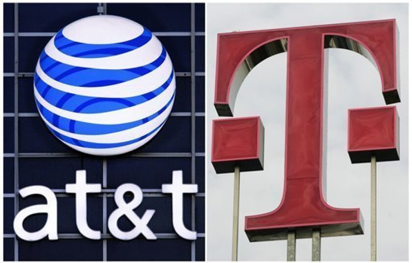 This photo combination shows logos for AT&T, left, and Deutsche Telekom AG. AT&T Inc. on Sunday, March 20, 2011 said it will buy T-Mobile USA from Deutsche Telekom AG in a cash-and-stock deal valued at $39 billion, becoming the largest cellphone company in the U.S. (AP Photo)