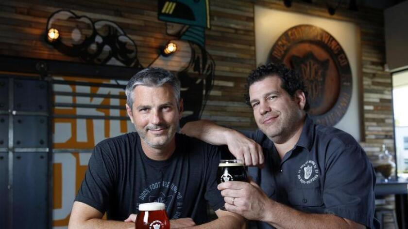 """Duck Foot Brewering Company owners """"Head Quack"""" Matt DelVecchio (left) and Brett Goldstock like beer. The brewery is located in the Miramar area on Kenamar Dr., has begun bottling some of their brews including The Looker, ChocoNut Lust, and The Contender. (Nancee E. Lewis)"""