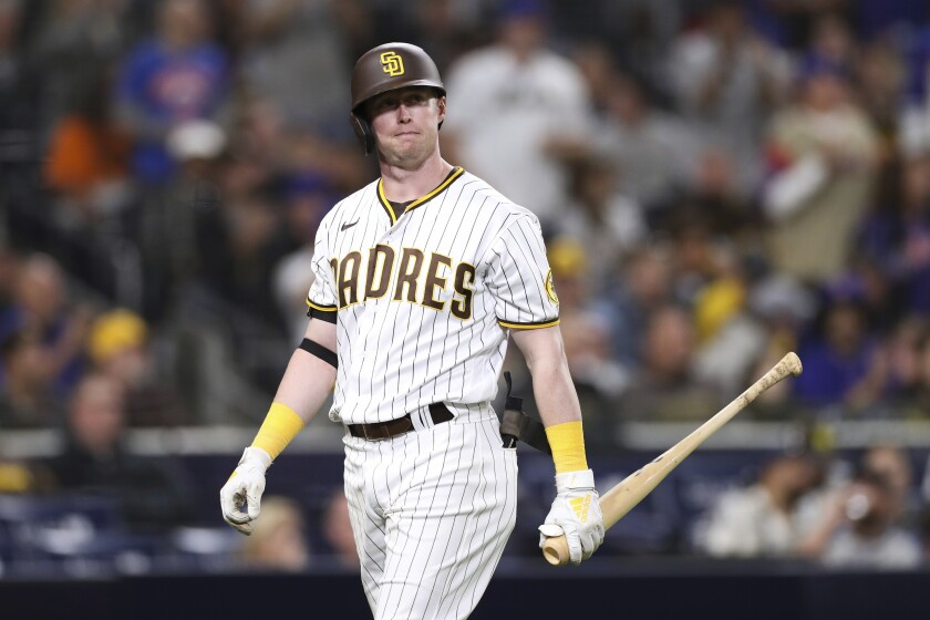 San Diego Padres' Jake Cronenworth walks back to the dugout after striking out.