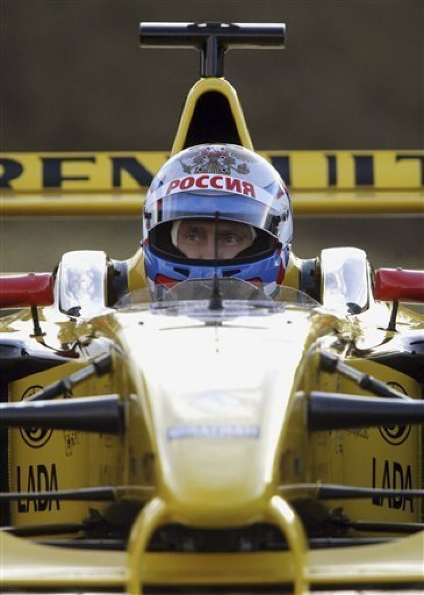 Russian Prime Minister Vladimir Putin prepares to drive a Renault racing car at the race track outside St. Petersburg, Russia, Sunday, Nov. 7, 2010. Putin tested his capacities as a Formula One driver. (AP Photo/RIA Novosti, Alexei Nikolsky, Pool)