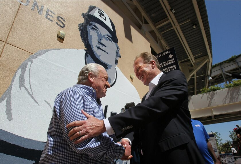 San Diego Mayor Kevin Faulconer greets former Padre Randy Jones in front of his new mural at the stadium.
