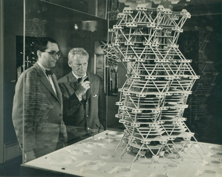 Jonas Salk with Louis Kahn, in front of a model of Kahn's Philadelphia City Tower project, 1958.