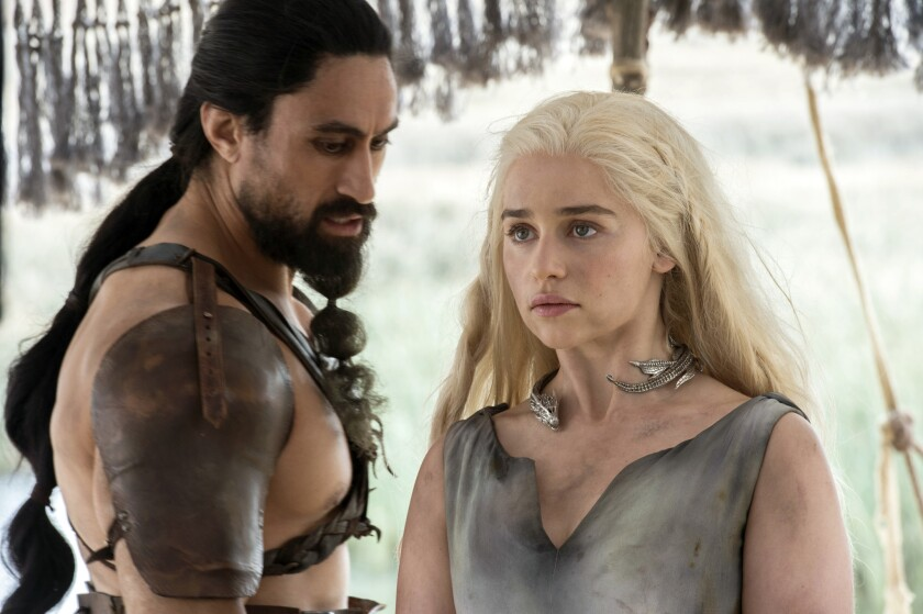 "Joe Naufahu and Emilia Clarke in ""Game of Thrones."""