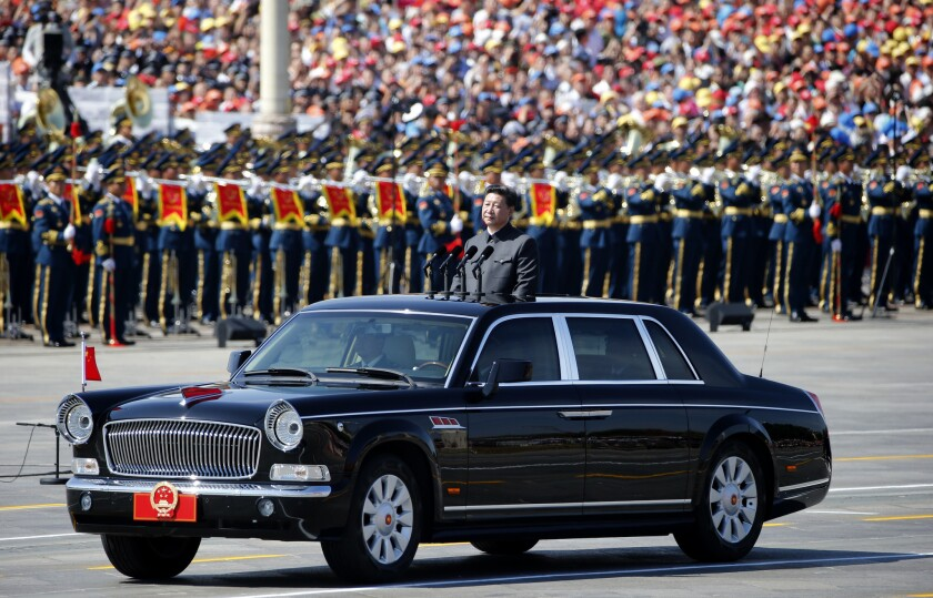 Chinese President Xi Jinping stands in a car to review the army during a parade commemorating the 70th anniversary of Japan's surrender during World War II, held in front of Tiananmen Gate in Beijing on Sept. 3.