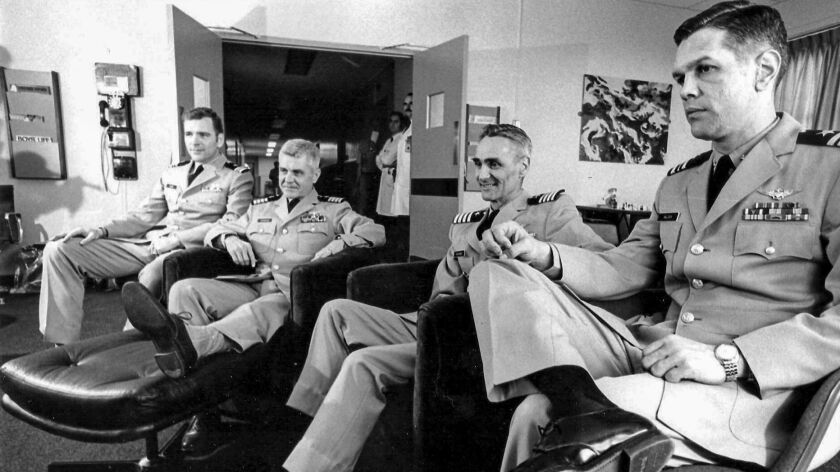 After missing it when it happened, four Vietnam POW returnees watch film of an Apollo moon shot on t
