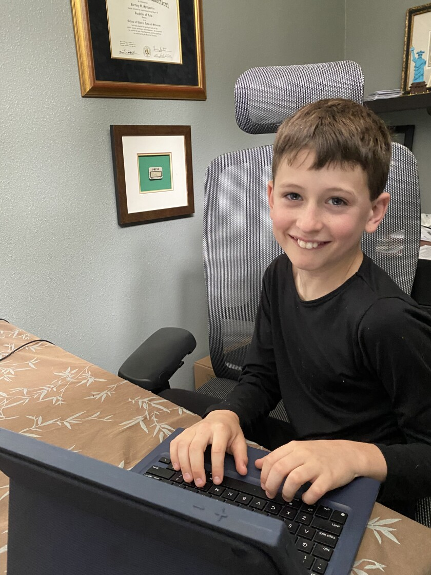 Beau, a Solana Santa Fe School fourth grader, works from home.