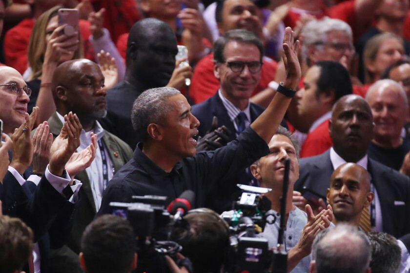 Former President Barack Obama attends Game 2 of the NBA Finals between the Toronto Raptors and Golden State Warriors.