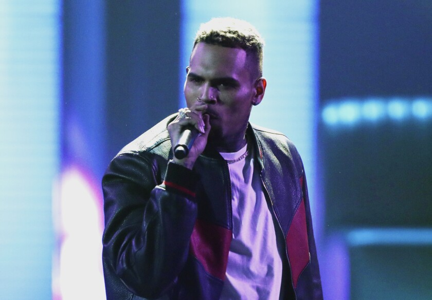 FILE - In this June 25, 2017, file photo, Chris Brown performs at the BET Awards at the Microsoft Theater in Los Angeles. Brown says he's having a high-end yard sale at his Los Angeles home, and a crowd has been gathering for hours. The singer posted a flyer on his Instagram and Twitter accounts that included his home address in the Tarzana neighborhood and says the event will start at 10 a.m. Wednesday and go until 7 p.m. (Photo by Matt Sayles/Invision/AP, File)