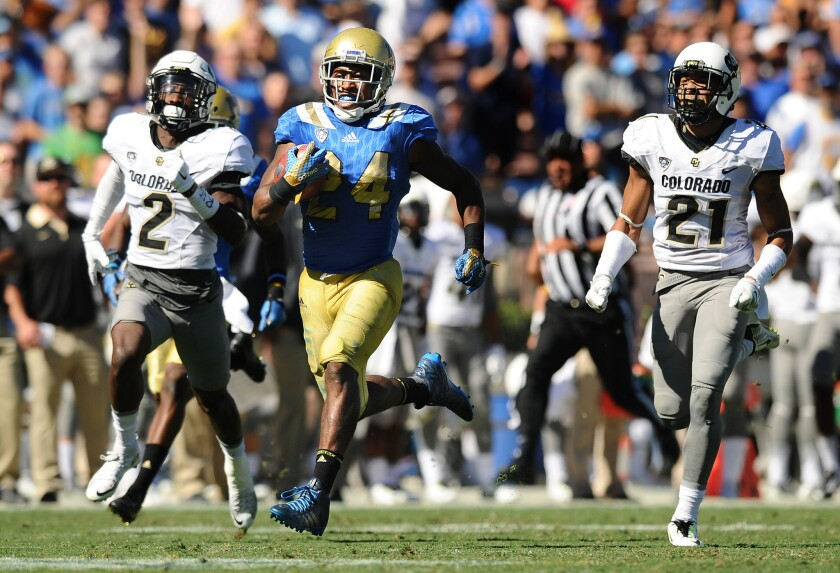 UCLA's Paul Perkins makes the offensive line look good