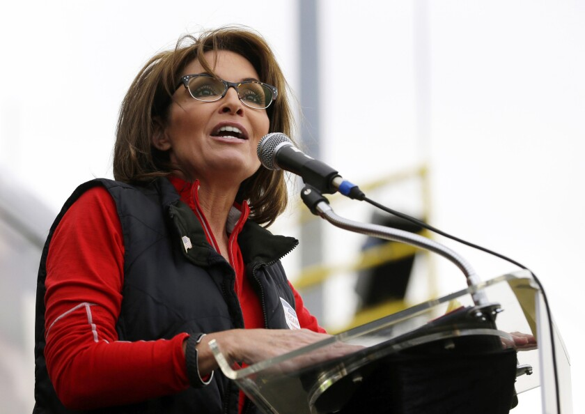 """The Sportsman Channel said Monday that it has hired former Alaska Gov. Sarah Palin to host a weekly outdoors-oriented program that will celebrate the """"red, wild and blue"""" lifestyle. The program, """"Amazing America With Sarah Palin,"""" is to debut in April."""