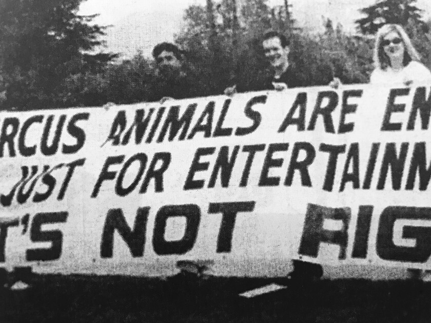 Animal rights activists in April 2000 protest a Culpepper Merriweather circus held as a fundraiser at Palm Crest Elementary School.