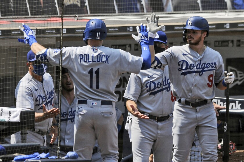 Dodgers' Gavin Lux, right, high-fives A.J. Pollock after Pollock hit a solo home run.
