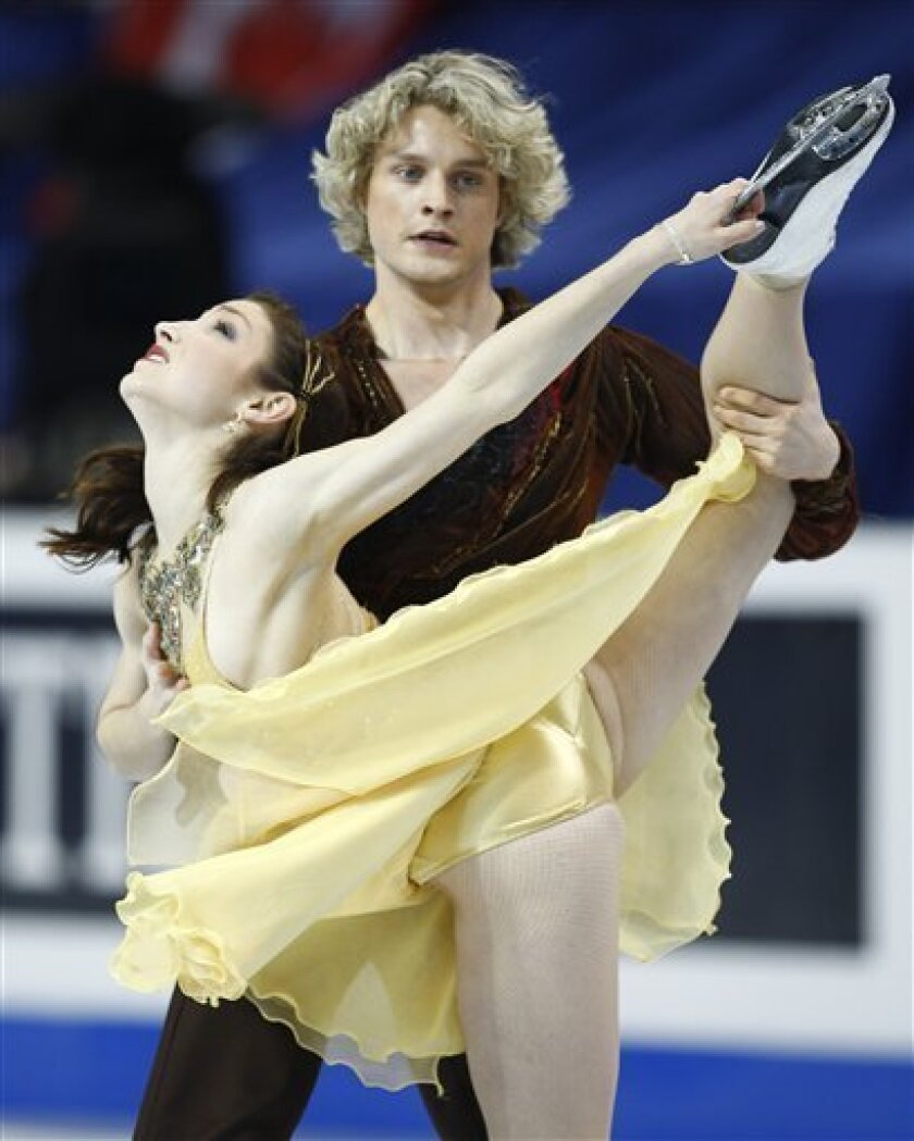 Meryl Davis and Charlie White of the United States. perform their free dance program in the ice dance competition at the ISU Four Continents Figure Skating Championships, Friday, Feb. 6, 2009 in Vancouver, British Columbia. The couple won the gold medal. (AP Photo/The Canadian Press, Paul Chiasson)