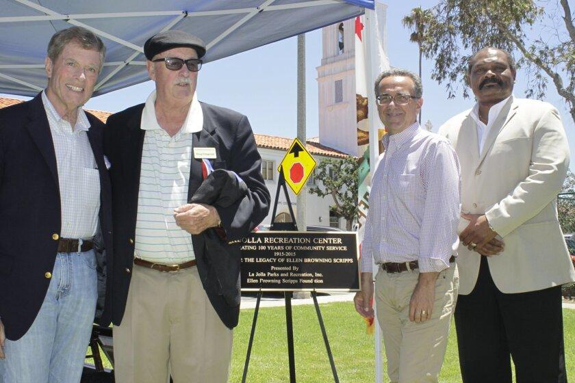 With the new centennial plaque are Doug Dawson, director Ellen B. Scripps Foundation; Doug Fitzgerald, president La Jolla Park & Rec, Inc.; Joe La Cava, trustee La Jolla Planning Association and Herman Parker, director San Diego Park & Rec.