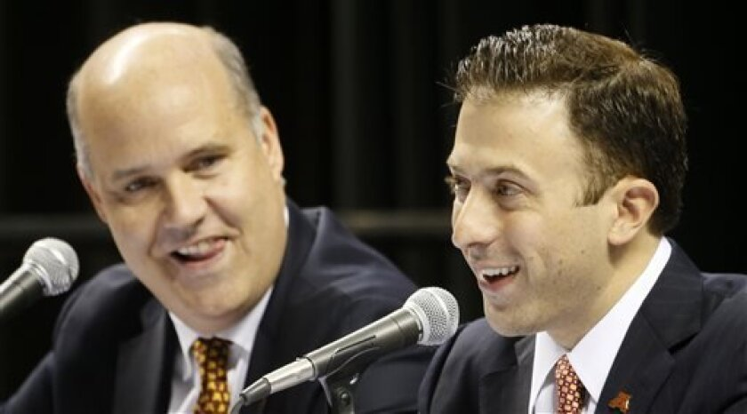 Minnesota athletic director Norwood Teague, left, looks on after introducing Richard Pitino as the new men's basketball coach during a news conference, Friday, April 5, 2013, in Minneapolis. (AP Photo/The Star Tribune, Brian Peterson) MANDATORY CREDIT; ST. PAUL PIONEER PRESS OUT; MAGS OUT; TWIN CITIES TV OUT