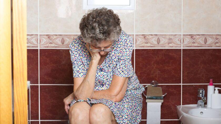 Senior woman in her bath room