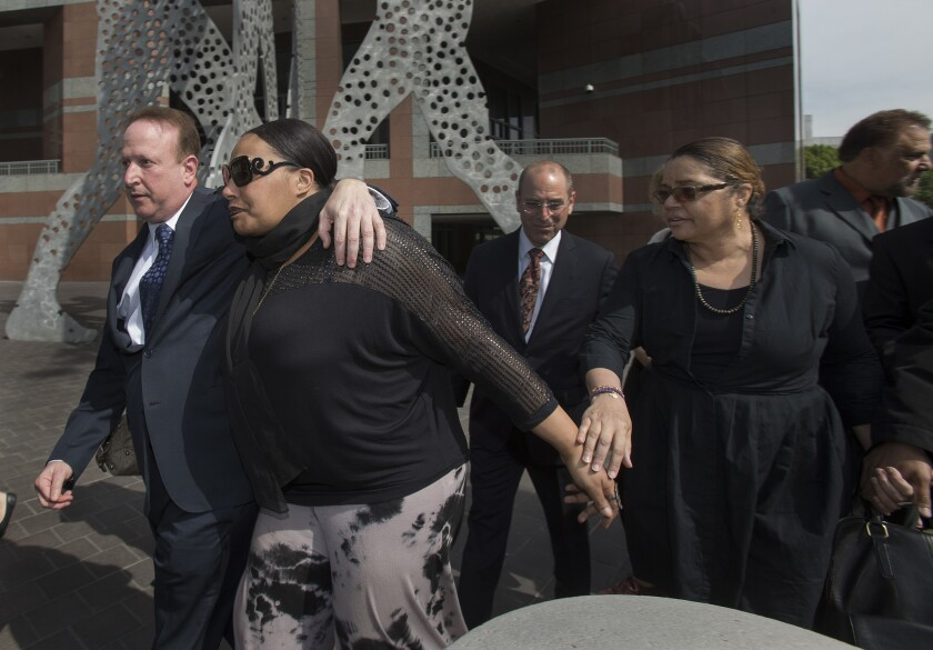 Nona Gaye, middle, daughter of the late Marvin Gaye, leaves the Roybal Federal Courthouse with attorney Richard Busch, left, and her dad's ex-wife Janice Gaye, right, after a federal jury found Pharrell Williams and Robin Thicke guilty of copyright infringement.
