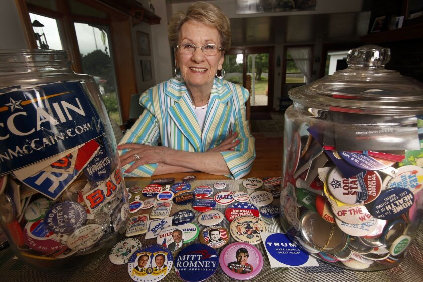 In this photo taken Aug. 21, 2015, Judy Galluzzo poses with campaign buttons she's collected over the years, in Salem, N.H. Few volunteers know the Republican stronghold of Salem better than Galluzzo, whose first race in the 1970s was an early campaign of former Gov. John H. Sununu. She's been active ever since, running campaigns on a volunteer basis for the local register of deeds, the county attorney and many more. (AP Photo/Jim Cole)