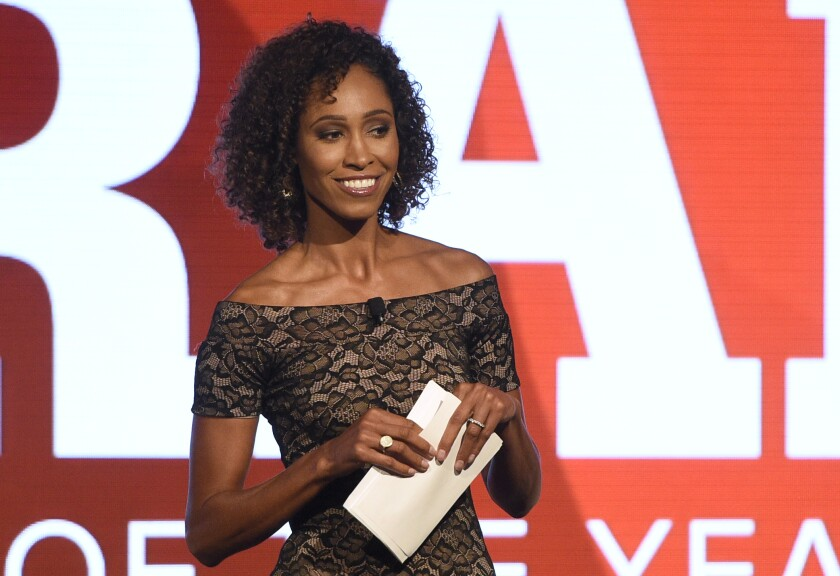 """FILE - In this July 11, 2017, file photo, Sage Steele speaks at the 15th annual High School Athlete of the Year Awards in Marina del Rey, Calif. Steele will not appear on ESPN's """"SportsCenter"""" the remainder of this week and has been pulled from moderating an upcoming network event following comments she made on a recent podcast. Steele appeared on a podcast hosted by former NFL quarterback Jay Cutler where she criticized ESPN and the Walt Disney Company's mandate for employees to receive the coronavirus vaccine. (AP Photo/Chris Pizzello, File)"""
