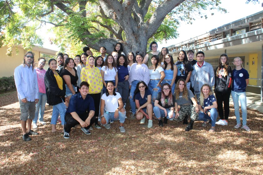 Members of the Mission Bay High School 2020 yearbook staff, with chief editor Kimberly Torres in front in dark glasses. Yearbook adviser Ron Lancia is on the left.