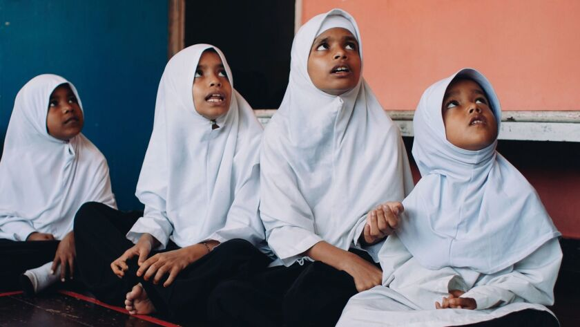 in Penang, Malaysia, Rohingya girls attend a community school run by a local nongovernmental organization that has condemned human rights abuses against the ethnic Muslim minority.