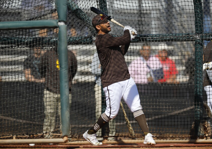 Tommy Pham bats during a spring training workout at Padres spring training in February.