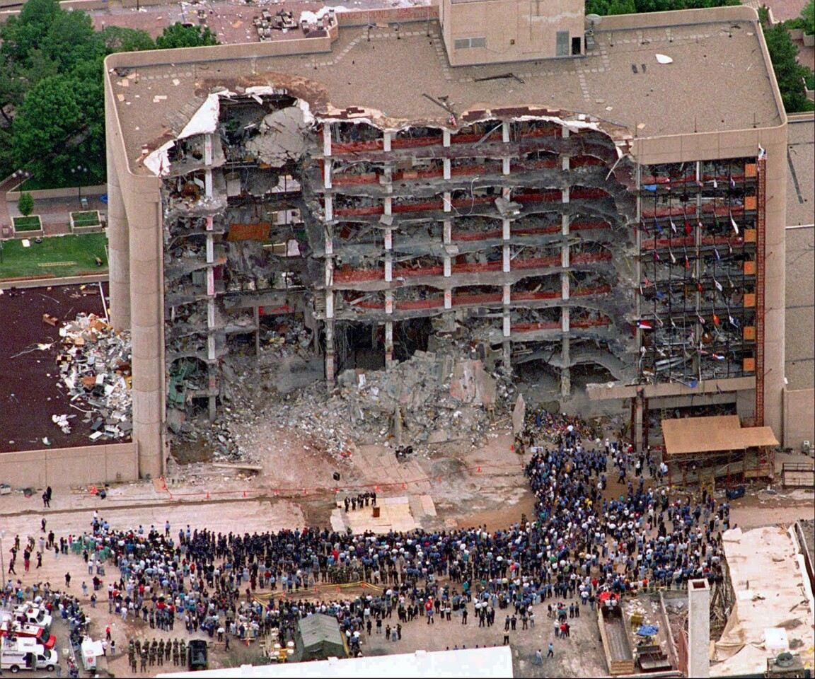 In this May 5, 1995 file photo, a group of search and rescue workers attends a memorial service in front of the bombedAlfred P. Murrah Federal Building in Oklahoma City.